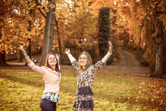 Happy sisters in a park Royalty Free Stock Photo