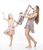 Happy sisters sing and dance. Stock Photography