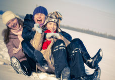 Happy sisters sledding Stock Photos