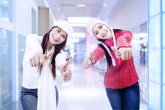Happy sisters on success in the office Stock Photos