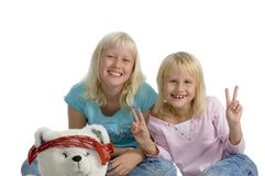 Happy sisters with teddy bear Stock Image