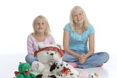 Happy sisters with teddy bears Royalty Free Stock Photo