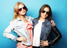 Happy sisters. Teenage girls in casual wear stock photography