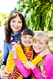 Happy sisters and their mother stock images