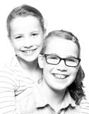 Happy sisters. Two sisters  in front of white background Stock Photography