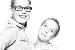 Happy sisters. Two sisters in front of white background Stock Photos