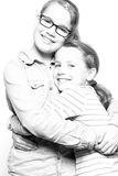 Happy sisters. Two sisters  in front of white background Stock Images