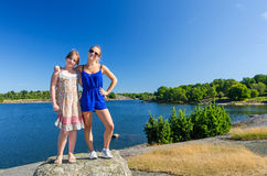 Happy sisters on vacation sunny trip Royalty Free Stock Photo