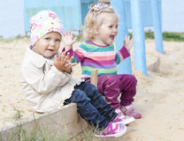 Happy sitting kids Royalty Free Stock Images
