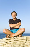 Happy sitting on a rock Royalty Free Stock Image