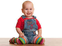 Happy sitting toddler in casual clothes Royalty Free Stock Photo