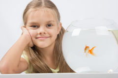 Happy six year old girl with an aquarium and a goldfish Stock Images
