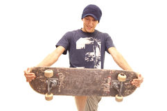 Happy skater. This skater seems to be happy because he breaks his old skate apart Royalty Free Stock Photos