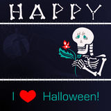 Happy skeleton with a flower on the background of the cemetery at night. Royalty Free Stock Photo