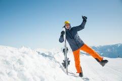 Happy skier sportsman at winter ski resort Royalty Free Stock Image