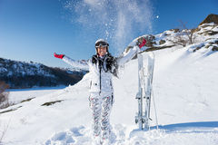 Happy skier in spray of snow on hill Royalty Free Stock Photos