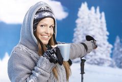 Happy skier taking a break on top drinking hot tea Stock Images