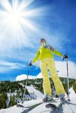Happy skier on top of the mountain. Happy young woman skier stand on top of the mountain royalty free stock photo