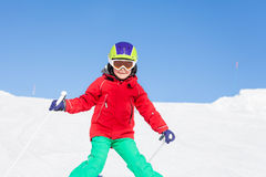 Happy skier walking down the hill in mountains Royalty Free Stock Photography