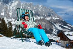 Happy skier in winter resort Royalty Free Stock Image