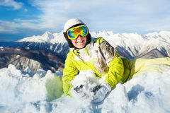 Happy skier woman rest laying in snow and smile Stock Photos