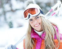 Happy skier woman in winter Stock Photos