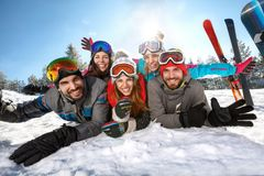 Happy skiers together on winter vacation stock images