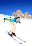 Happy skiing. A picture of a young happy woman skiing in the Alpes Royalty Free Stock Image