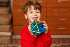 Happy skillful little boy holding toy Stock Images