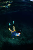 A happy skin diving girlin the sea. royalty free stock photography