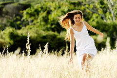 Happy skipping girl Stock Photos