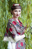 Happy  slavonic woman near the willow tree Royalty Free Stock Photo