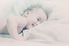 Happy sleepy baby Stock Images