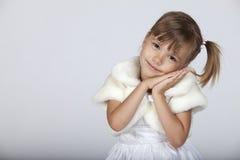 Happy sleepy little girl. Portrait of a little cute girl gesturing sleep Royalty Free Stock Photos