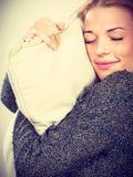 Happy sleepy woman holding cozy pillow. Sleep time, warm bedding, tiredness concept. Happy sleepy tired woman smiling and holding cozy white pillow royalty free stock photos