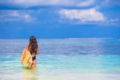 Happy slender surf woman at white beach with Royalty Free Stock Photography