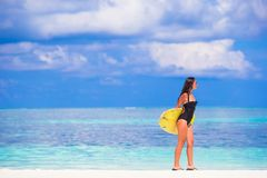 Happy slender surf woman at white beach with Stock Images