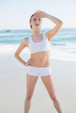 Happy slender woman standing hands on hips looking away Stock Images