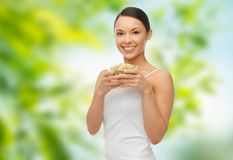 Happy slim woman with mung bean sprouts stock photos