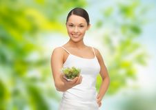 Happy slim woman with vegetable salad Stock Images