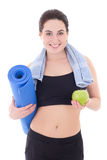 Happy slim woman with yoga mat, towel and apple isolated on whit Stock Photos