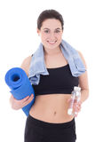 Happy slim woman with yoga mat, towel and bottle of water isolat Stock Photo