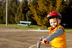 Happy small boy out riding his bicycle Stock Photography