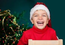 Happy small boy in santa hat Royalty Free Stock Photos