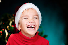 Happy small boy in santa hat Royalty Free Stock Image