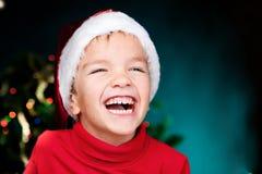 Happy small boy in santa hat Royalty Free Stock Image