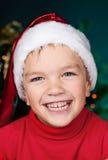 Happy small boy in santa hat Stock Photos