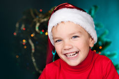 Happy small boy in santa hat Stock Image