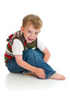 Happy small boy in the studio stock image