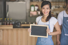 Happy small business owner ready to open her cafe Royalty Free Stock Photo